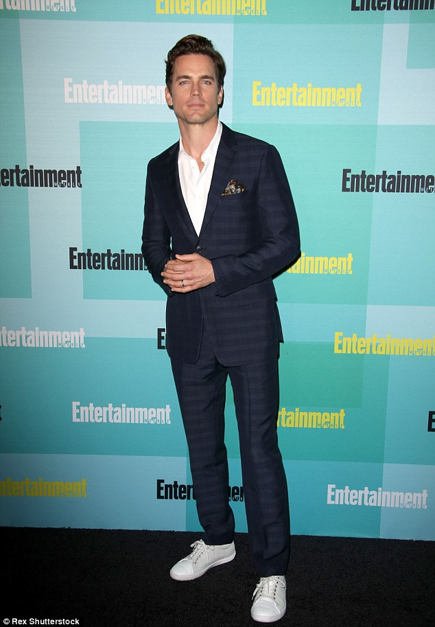 Man of style: Matt Bomer looker dapper in a sharp blue suit that was teamed with casual sneakers
