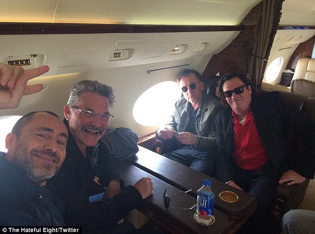 Bro' fest! Tim Roth (2-R) - who plays Oswaldo 'The Little Man' Mobray - sat by a window while Samuel L. Jackson was noticeably missing from the gang
