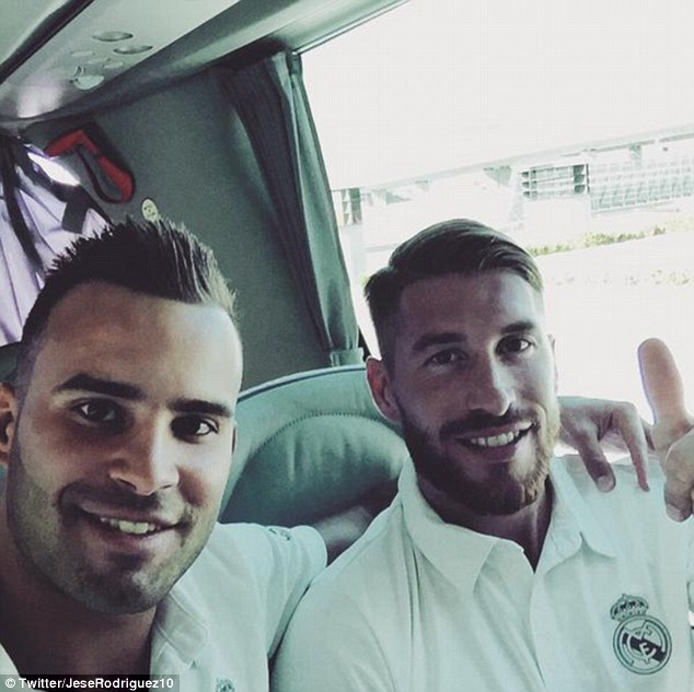 Sergio Ramos, pictured with Jese Rodriguez, has been named in Real Madrid's squad for their pre-season tour