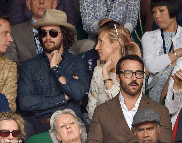 Aaron Taylor-Johnson, 25 (left), took to Centre Court in an unsuitably dark ensemble, along with wife Sam, 48 (right). Actor Jeremy Piven, 49 was also seen at the gruelling match (front)