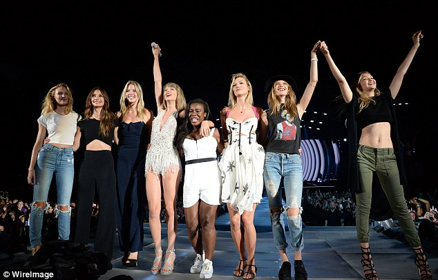 Beauties: Taylor set about recreating the star-studded music video live on stage as part of her 1989 Tour withCandice Swanepoel, Lily Aldridge,  Uzo Aduba, Karlie Kloss, Behati Prinsloo and Gigi Hadid