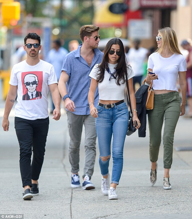 Casual: The Camp Rock actor was sporting a T-shirt bearing designer Karl Lagerfeld's face