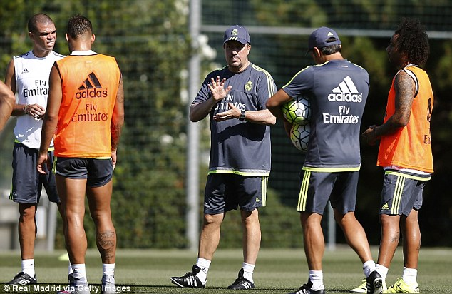 New Real Madrid boss Rafa Benitez (centre) leads his players in a training session on Saturday