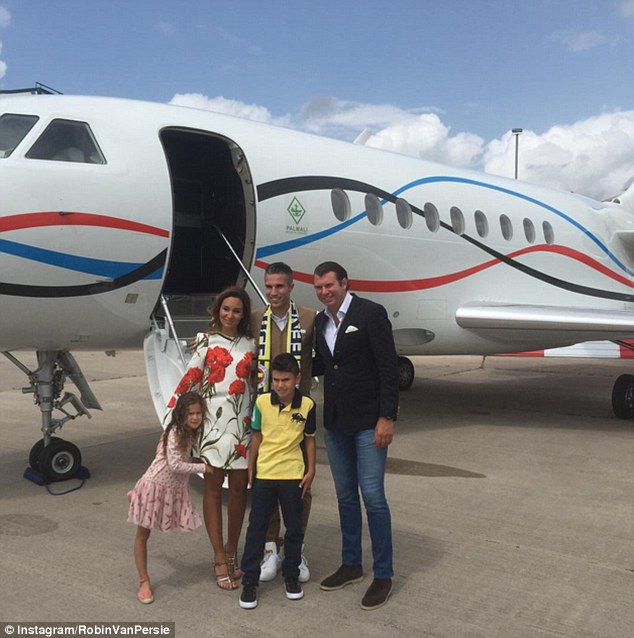 Van Persie poses with his wife Bouchra and his two children before boarding the plane to Turkey