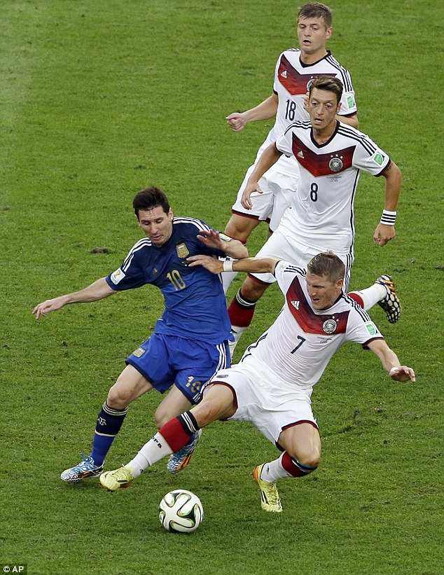 Schweinsteiger gets stuck in to Lionel Messi during last year's World Cup final in the Maracana