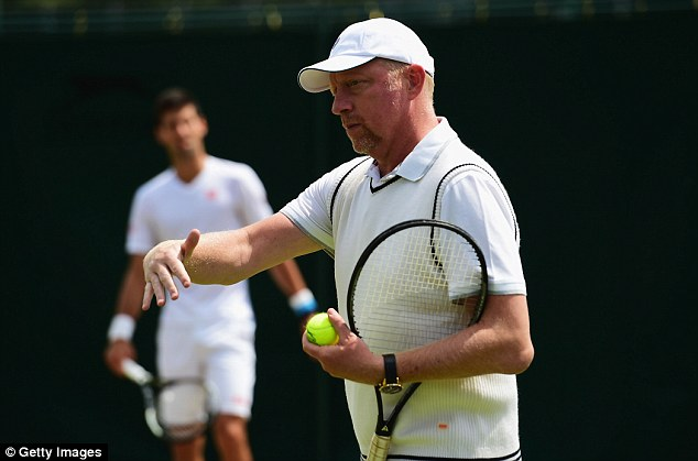 Djokovic in the background as he takes some advice from his coach Boris Becker