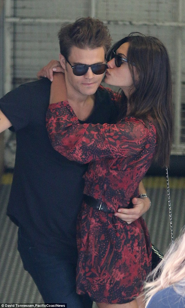 Loved up: Paul Wesley and Phoebe Tonkin embrace at the Comic-Con International: San Diego event on Saturday in California