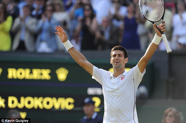 Djokovic celebrating his five-set victory over Federer in the 2014 Wimbledon final