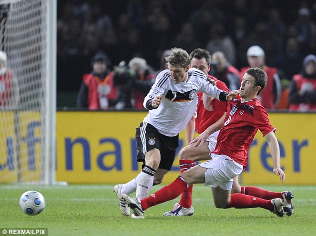 Robson believes Schweinsteiger (pictured in 2008) can play a similar role at United as Michael Carrick