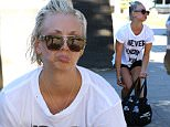 Studio City, CA - Actress, Kaley Cuoco, got upset when she realized she had forgotten her car keys at her gym.  She was seen leaving the gym in a graphic tee that read, 'Never Ending Fun', hot pink bra, black shorts, sandals. AKM-GSI       July 13,  2015 To License These Photos, Please Contact : Steve Ginsburg (310) 505-8447 (323) 423-9397 steve@akmgsi.com sales@akmgsi.com or Maria Buda (917) 242-1505 mbuda@akmgsi.com ginsburgspalyinc@gmail.com
