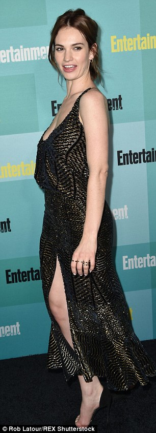 Sexy ensemble: She wore a low-cut heavily embellished beaded dress in black which finished at the calf and had a split going up the front