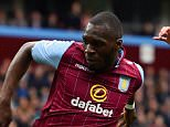 BIRMINGHAM, ENGLAND - MAY 09: Christian Benteke of Aston Villa misses a chance at goal with Carl Jenkinson of West Ham United during the Barclays Premier League match between Aston Villa and West Ham United at Villa Park on May 9, 2015 in Birmingham, England.  (Photo by Stu Forster/Getty Images)