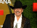 """HOLLYWOOD, CA - OCTOBER 09:  Singer Joan Sebastian poses in the pressroom with the awards for 'Ranchero/Mariachi Album """"13 Celebrando El 13' and Ranchero/Mariachi Artist of the year at the 2013 Billboard Mexican Music Awards held at the Dolby Theatre on October 9, 2013 in Hollywood, California.  (Photo by Mark Davis/Getty Images)"""