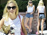 14.JULY.2015 - LOS ANGELES - USA *** EXCLUSIVE ALL ROUND PICTURES *** ENGLISH SINGER/ SONGWRITER PIXIE LOTT SHOWS OFF HER  SLIM PHYSIQUE IN SOME VERY SHORT DENIM HOT PANTS AS SHE SOAKS UP THE CALIFORNIA SUNSHINE WHILST WAITING FOR HER RIDE TO THE AIRPORT. BYLINE MUST READ : XPOSUREPHOTOS.COM ***UK CLIENTS - PICTURES CONTAINING CHILDREN PLEASE PIXELATE FACE PRIOR TO PUBLICATION *** **UK CLIENTS MUST CALL PRIOR TO TV OR ONLINE USAGE PLEASE TELEPHONE  44 208 344 2007**