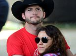 FILE  JULY 05, 2015: According to reports, Mila Kunis and Ashton Kutcher married over the 4th of July weekend. Their representatives have not confirmed if they are married or not. Kunis and Kutcher worked together on That 70s Show from 1998-2006. They became a couple in 2012 and their daughter was born in 2014. INDIO, CA - APRIL 25:  Actors Ashton Kutcher and Mila Kunis attend day 1 of 2014 Stagecoach: California's Country Music Festival at the Empire Polo Club on April 25, 2014 in Indio, California.  (Photo by Frazer Harrison/Getty Images for Stagecoach)