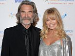 """BEVERLY HILLS, CA - NOVEMBER 21:  Hosts Kurt Russell (L) and Goldie Hawn attend Goldie Hawn's inaugural """"Love In For Kids"""" benefiting the Hawn Foundation's MindUp program transforming children's lives for greater success at Ron Burkles Green Acres Estate on November 21, 2014 in Beverly Hills, California.  (Photo by Jason Merritt/Getty Images for The Hawn Foundation)"""
