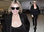 15.JULY.2015  - LONDON  - UK *** EXCLUSIVE ALL ROUND PICTURES *** BRITISH SUPERMODEL KATE MOSS IS PICTURED LOOKING CHIC DRESSED HEAD TO TOE IN BLACK AS SHE ARRIVES AT HEATHROW AIRPORT IN LONDON. BYLINE MUST READ : XPOSUREPHOTOS.COM ***UK CLIENTS - PICTURES CONTAINING CHILDREN PLEASE PIXELATE FACE PRIOR TO PUBLICATION *** **UK CLIENTS MUST CALL PRIOR TO TV OR ONLINE USAGE PLEASE TELEPHONE  442083442007