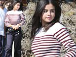 Please contact X17 before any use of these exclusive photos - x17@x17agency.com   Selena Gomez spent the day in Malibu doing a nautical themed photoshoot. The singer looked adorable in stripes and sailor pants  July 14, 2015 X17online.com