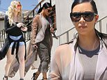 Kim Kardashian  has her game face on with a serious look in beige shirt dress heading to film reality show with her sisters at Carrara Pastries July 14, 2015 X17online.com