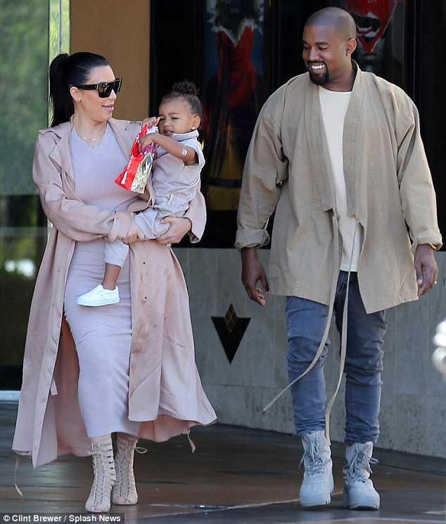 Snack time!: North's parents laughed as they watched her tuck into a mini bag of popcorn