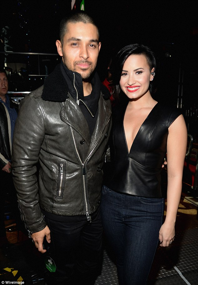 Lovebirds: Wilmer cosied up to his singer girlfriend when they attended KIIS FM's Jingle Ball in Los Angeles in December 2014