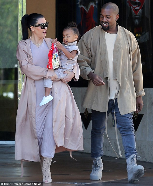 Sunday funday: Kim Kardashian and Kanye West looked thrilled to be spending some time with their first born