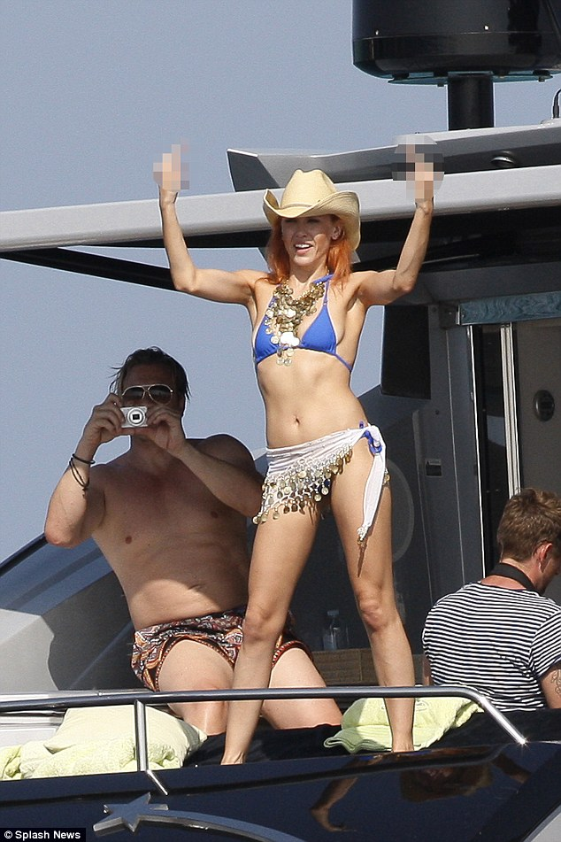 One finger salute: The day before Imogen was seen giving onlookers the finger as she partied on a yacht