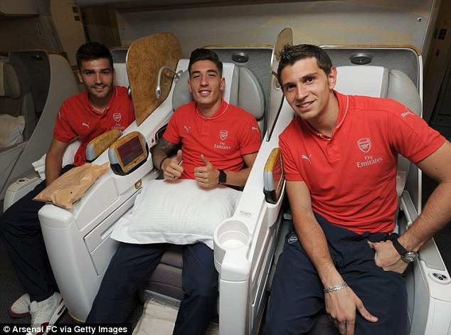 Arsenal youngsters Jon Toral, Hector Bellerin and Emiliano Martinez on the Emirates plane at Stansted