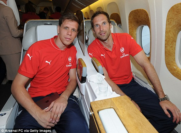Wojciech Szczesny and Petr Cech sat next to each other on the 13-hour flight from London to Singapore