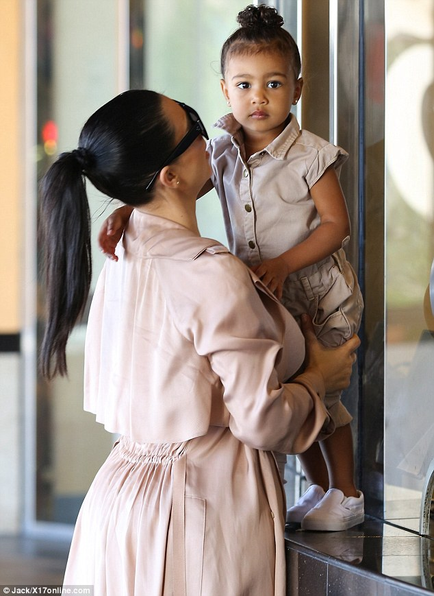 So cute: North looked as though she was ready to go on safari in her khaki onesie and white trainers