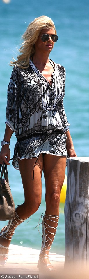 Summer fun: The star's summer tan was on display thanks to the high hemline of her print cover-up