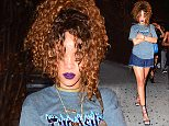 EXCLUSIVE: Rihanna was spotted clubbing at Griffin Nightclub in NYC late Monday night. She partied until 4am with other celebrities such as French Montana. She left the club, surrounded by her security guards, who have escorted her after a recent stalker scare. The Barbadian songstress wore a denim ripped skirt, and a grey Thrasher T-shirt, with some heels  Pictured: Rihanna Ref: SPL1078773  140715   EXCLUSIVE Picture by: 247PAPS.TV / Splash News  Splash News and Pictures Los Angeles: 310-821-2666 New York: 212-619-2666 London: 870-934-2666 photodesk@splashnews.com