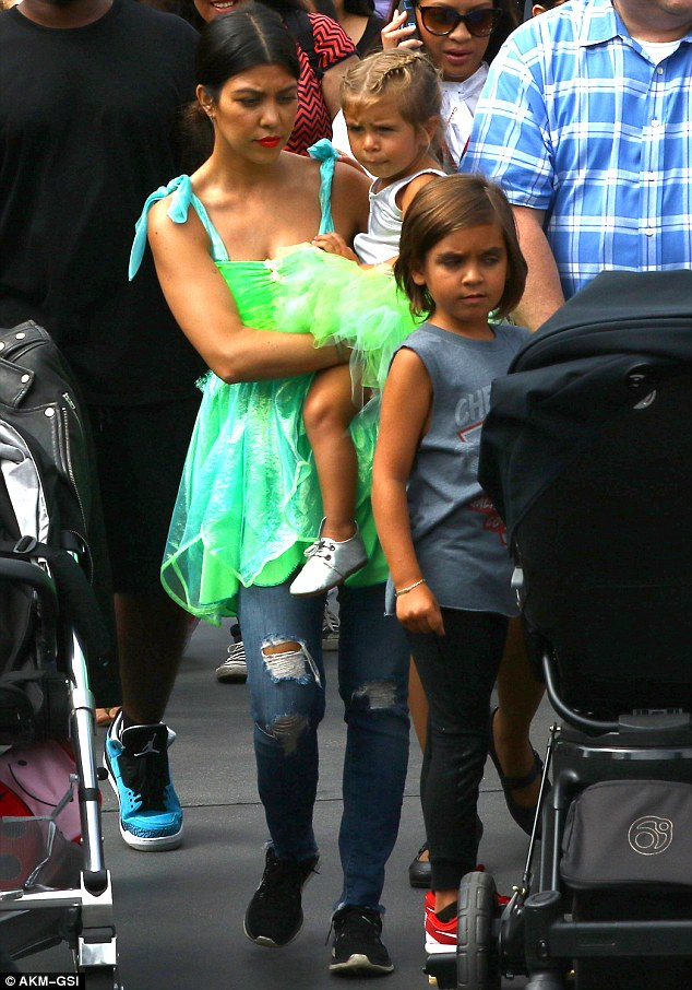 Staying strong: Kourtney took Mason and Penelope to Disneyland on Wednesday to celebrate Penelope's third birthday