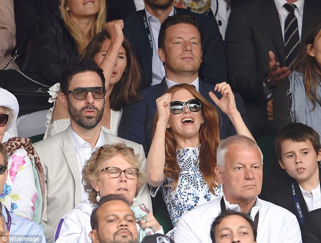 Caught in a moment: Australian actress Isla cheers on the stars as they reach match point