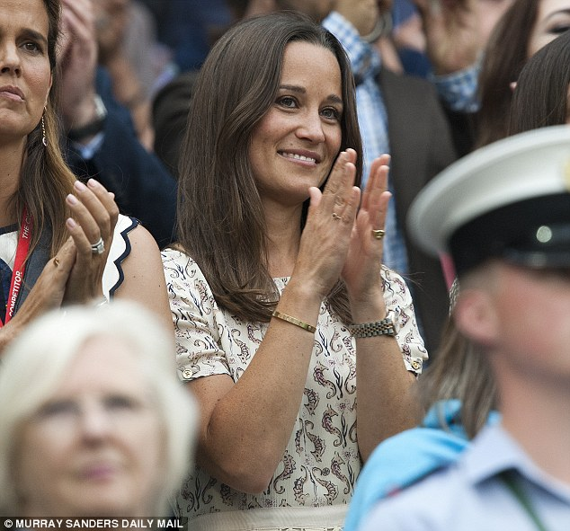 A very regal approach: Pippa Middleton claps like a Princess's sister should