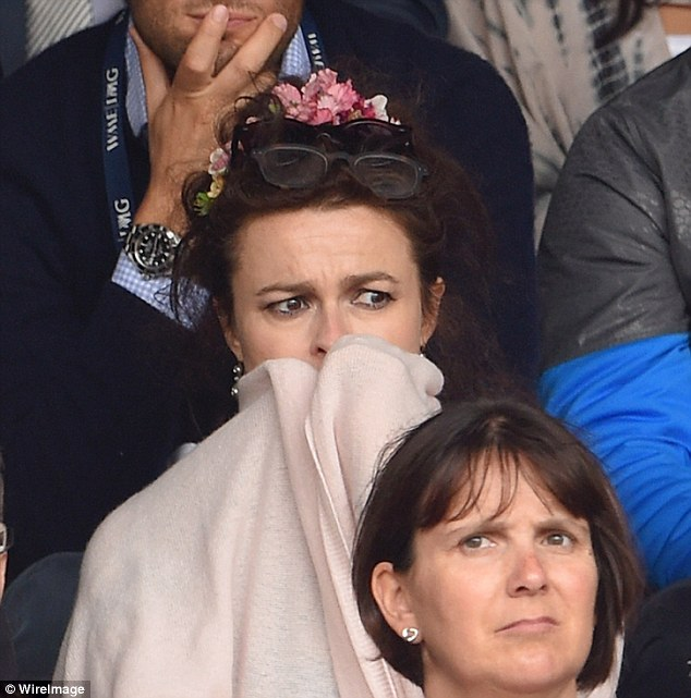 Scary stuff: Helena can hardly handle the tension of the match as she watches from behind a blanket
