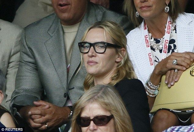 Going for the Clark Kent look? The blonde performer was clearly taking the event seriously - as she wore a pair of studious-looking glasses in a thick, black frame