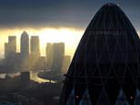 "A general view of the 'Gherkin' and Canary Wharf at sunrise in the City of London as confidence in the state of the economy among small and medium-sized businesses is increasing, according to a new report.  Half believe the economy will improve in 2015, up from a third in a previous poll two years ago, a survey of more than 500 small and medium-sized enterprises (SMEs) showed. Employment and pension regulations, tax compliance, and health and safety were named as the biggest problems for SME bosses. Jason Eatock, of insurance firm Zurich, which conducted the survey, said: ""It's clear that regulation is still a major headache for small and medium businesses which may not have the manpower to keep on top of the raft of new legislation.""   PRESS ASSOCIATION Photo. Issue date: Monday February 9, 2015 See PA story INDUSTRY Business. Photo credit should read: Stefan Rousseau/PA Wire"
