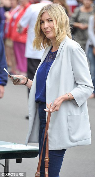 See and be seen: Lisa Faulkner arrives at Wimbledon - shortly before Sherlock actor Benedict Cumberbatch