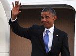 President Barack Obama waves as he arrives at Tinker Air Force Base, Wednesday, July 15, 2015, in Oklahoma City, Okla. (AP Photo/Tyler Drabek)