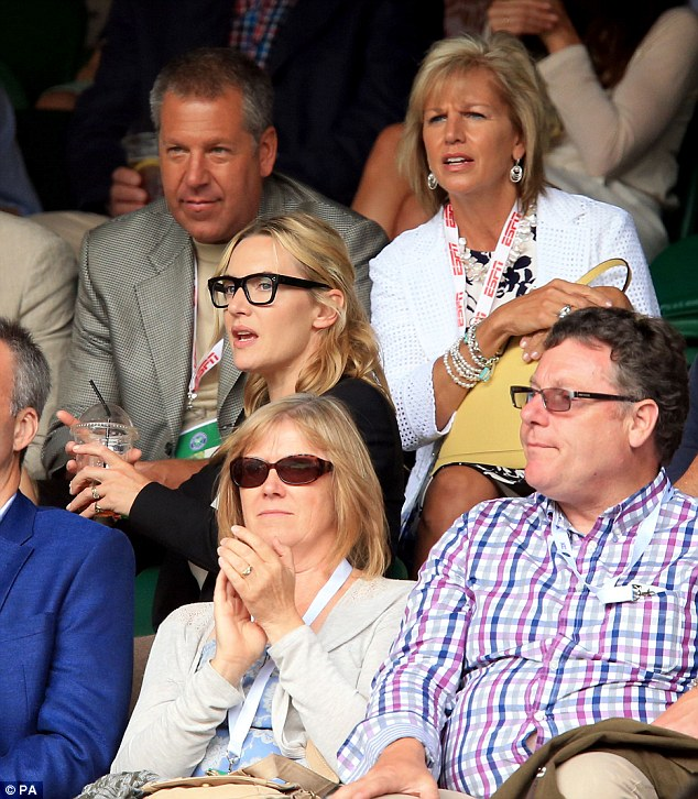 Can't take her eyes off Centre Court! Kate was loving the nail-biting finale, which saw Federer lose