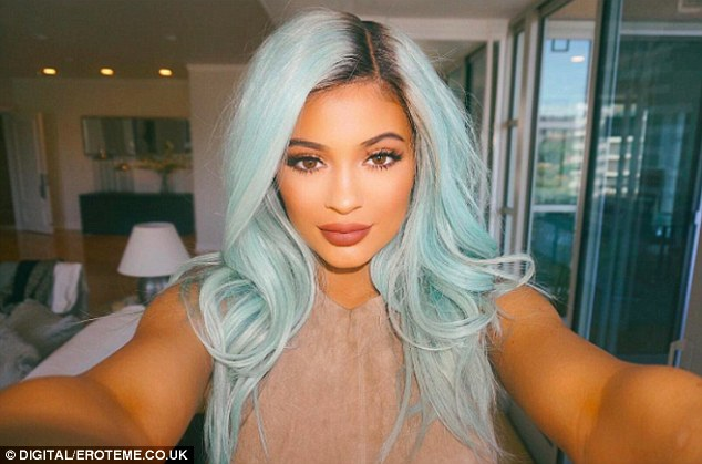 No more: The past few days saw Kylie rocking an electric blue hairstyle but Saturday's appearance showed that the TV star had retired the look