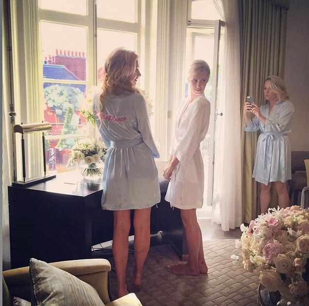 Paris posted a touching snap of the sisters preparing for the big day in a suite in Claridge's hotel in Mayfair
