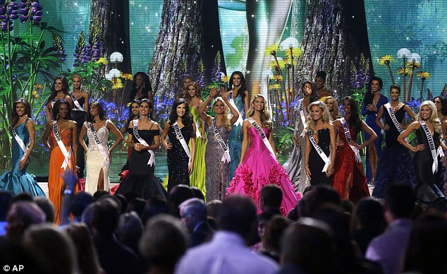 Tonight's the night: Contestants wave onstage at the conclusion of the preliminary round of the 2015 Miss USA Pageant in Baton Rouge, Lousiana on Wednesday