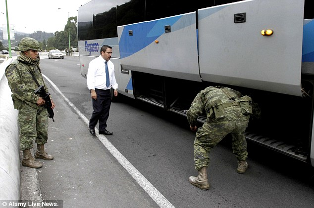 Manhunt: Soldiers of Mexican Army check a coach at a tollbooth of Mexico-Toluca highway, in Mexico City