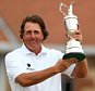 File photo dated 21/07/2013 of USA's Phil Mickelson celebrates with the Claret Jug after winning the 2013 Open Championship at Muirfield Golf Club, East Lothian. PRESS ASSOCIATION Photo. Issue date: Tuesday July 8, 2014. When Phil Mickelson arrived in Scotland 12 months ago, he had never won a tournament on British soil and admitted the greatest challenge of his career was adapting to links-style golf. See PA story GOLF Open Mickelson. Photo credit should read: Mike Egerton/PA Wire.