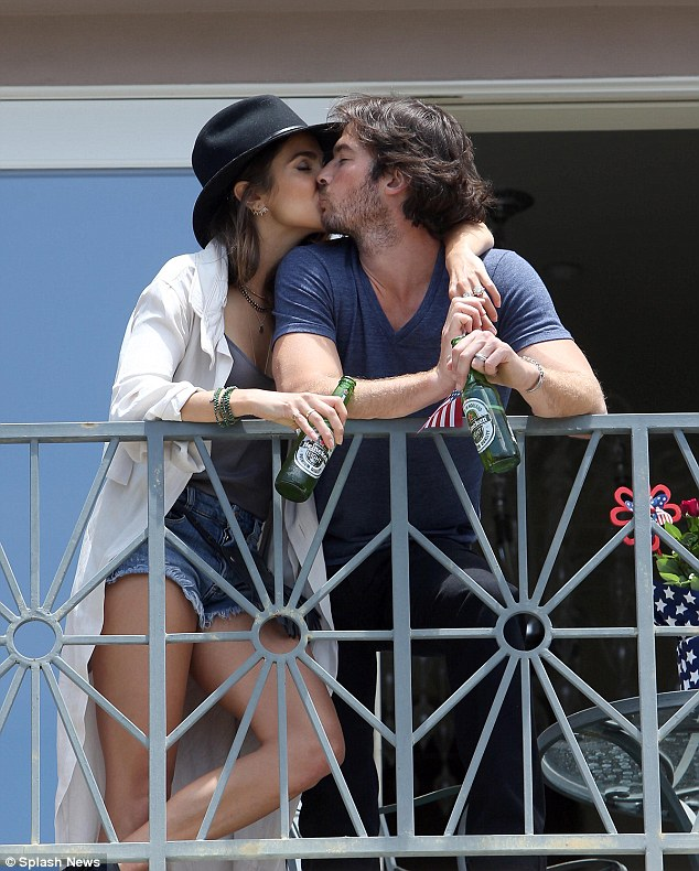Newlyweds: After just nine months of dating, Ian and Nikki were married in Malibu in April; here the couple are seen celebrating the Fourth of July with some suds and a smooch
