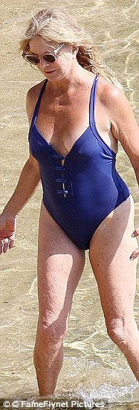 The 69-year-old appeared to confident and comfortable while splashing in the sea