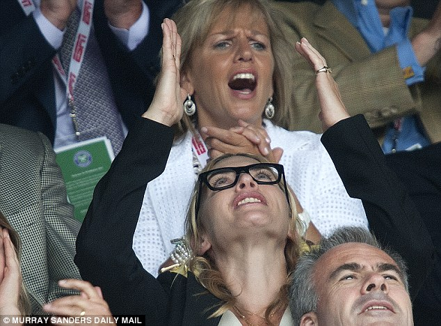 Good heavens: Kate looks to the skies as she struggles to deal with another near-miss from Federer