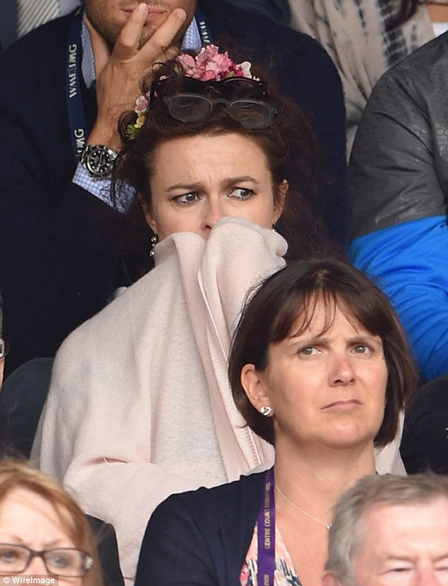 On edge: Helena Bonham Carter couldn't hide the tension as she watched the dramatic Wimbledon final between Roger Federer andNovak Djokovic in London on Sunday